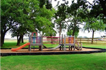 Playground in Surrounded by Grass and Trees